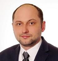Deutschsprachiger Anwalt berät in seiner Kanzlei in Warschau.
